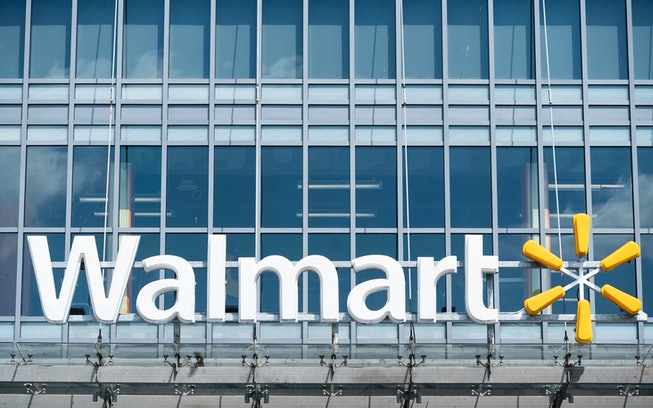 Glass storefront featuring Walmart name and logo