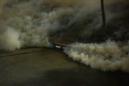 A tear gas canister emitting spray. We asked doctors how tear gas can affect your period.