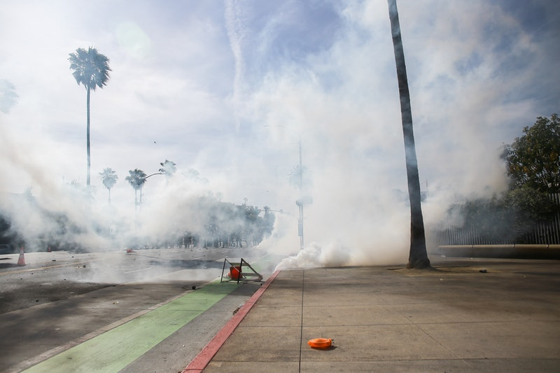 Tear gas in an empty street during Black Lives Matter protests. Can Tear Gas Affect Your Period? Doc...