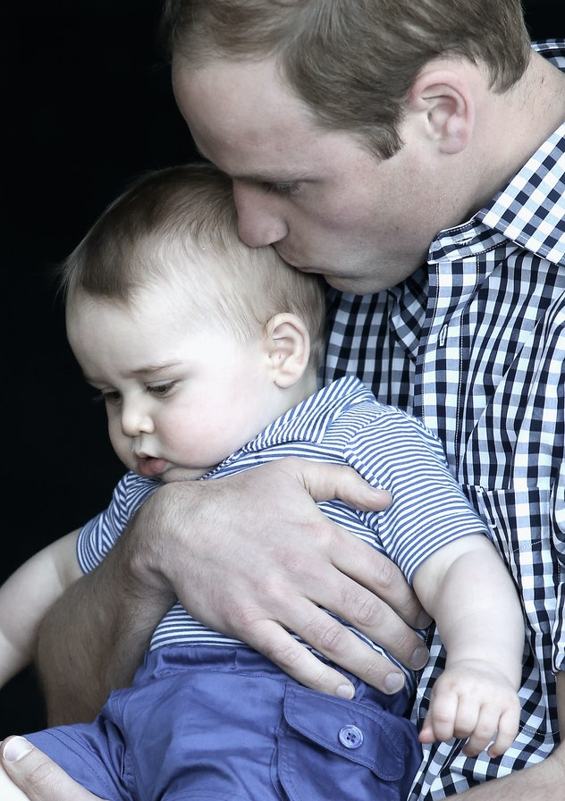 Prince William gives his baby boy a good snuggle at the zoo.