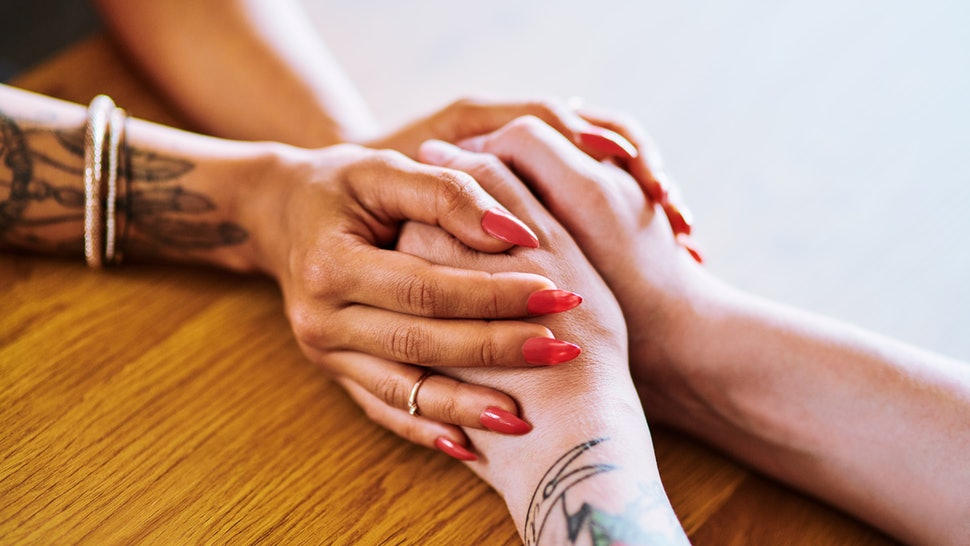 Two women's hands close up. PTSD, or post-traumatic stress disorder, can affect memory in multiple ways.