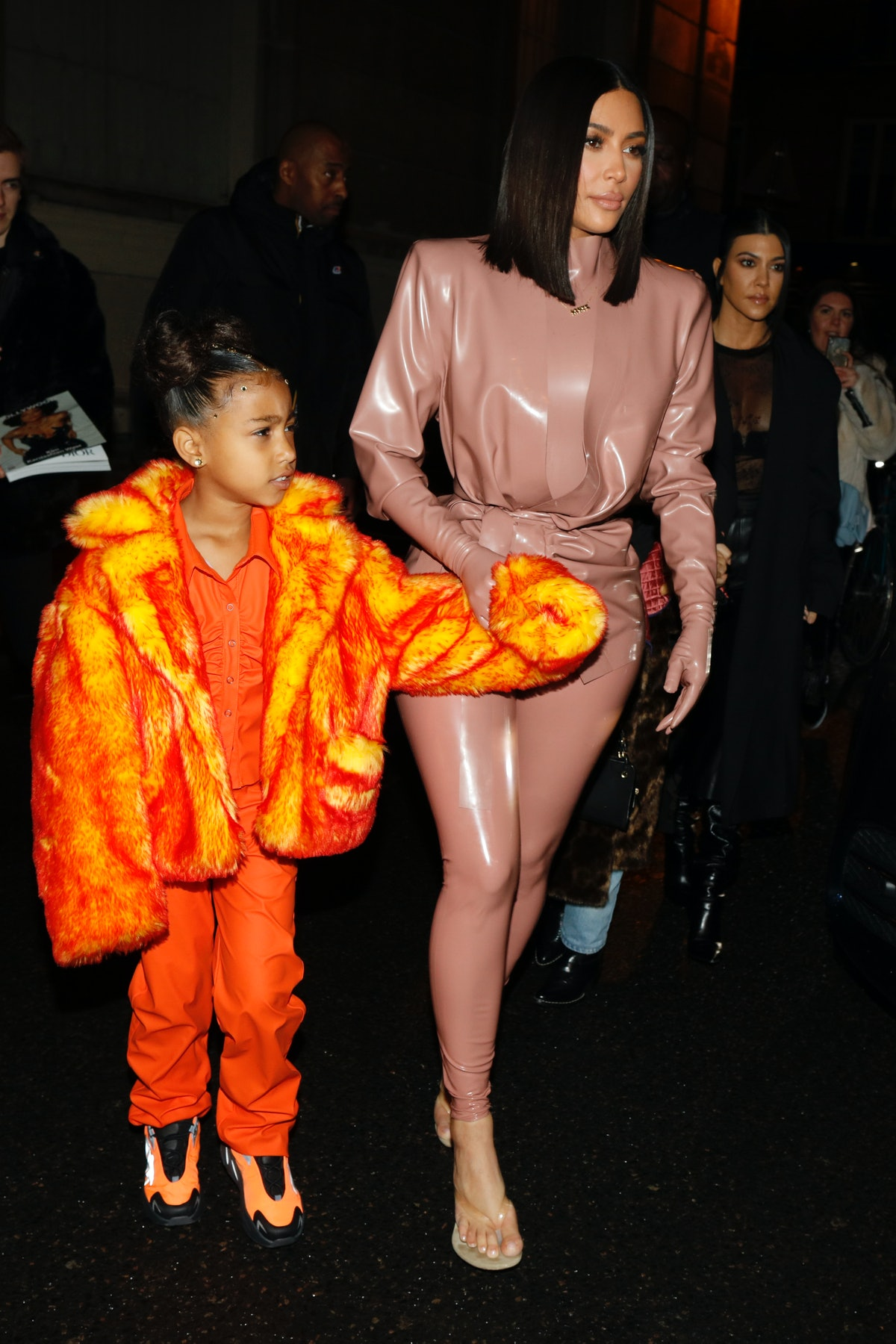 Kim Kardashian steps out in a latex bodysuit with daughter North West.