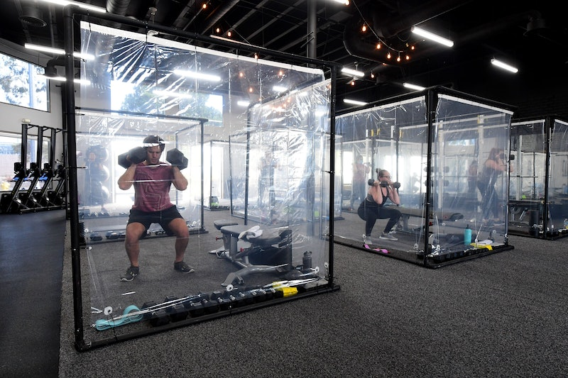 These Photos Of Pandemic Plastic Fitness Pods Are As Post-Apocalyptic As You'd Imagine