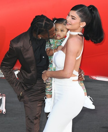 Travis Scott gives daughter Stormi a smooch.