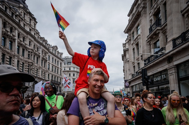 A boy and a man celebrate Pride together