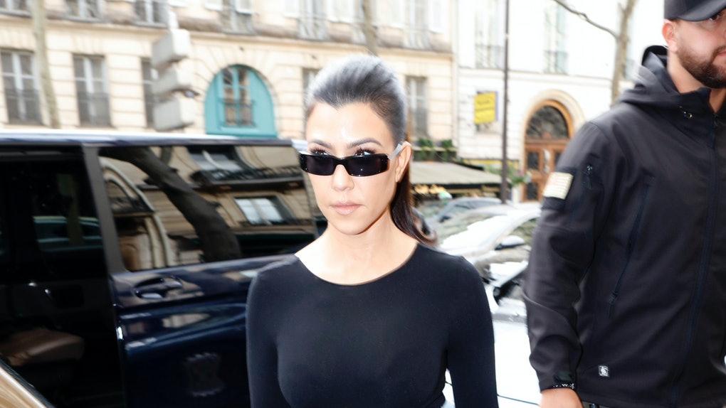 Kourtney Kardashian steps out in an all-black ensemble.