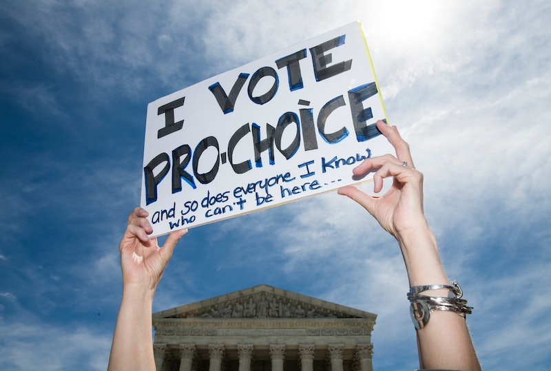 "A woman holds a sign saying ""I vote pro-choice."" Tennessee's 6-Week Abortion Ban Hurts Patients & Providers, A Doctor Says"
