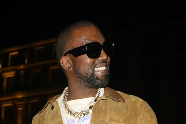 Kanye West steps out in a suede jacket.