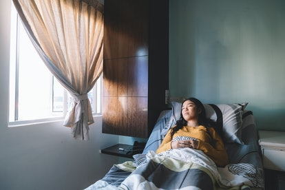 A woman dreams. Dreams about natural disasters may be the brain's natural response to boredom, stres...
