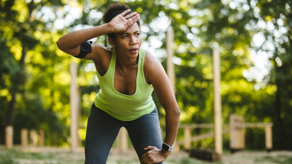 A woman sweats outside in warm weather. Humidity can affect the body in multiple ways.