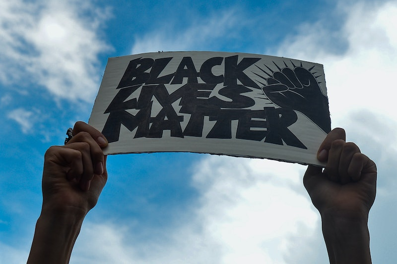 A woman marches in a Black Lives Matter march. Confronting racism online isn't just the duty of people of color, and it can be very powerful.