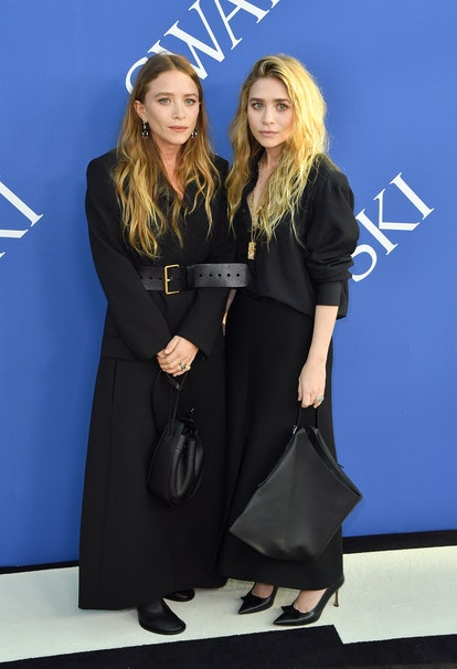 US fashion designer Mary-Kate Olsen (L) and Ashley Olsen arrives at the 2018 CFDA Fashion awards Jun...
