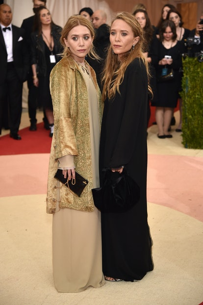 """Ashley Olsen (L) and Mary-Kate Olsen attend the """"Manus x Machina: Fashion In An Age Of Technology"""" C..."""