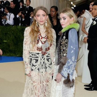 """Mary-Kate Olsen (L) and Ashley Olsen attend the """"Rei Kawakubo/Comme des Garcons: Art Of The In-Between"""" Costume Institute Gala at Metropolitan Museum of Art on May 1, 2017 in New York City."""