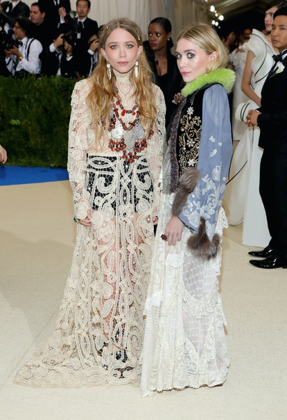 """Mary-Kate Olsen (L) and Ashley Olsen attend the """"Rei Kawakubo/Comme des Garcons: Art Of The In-Betwe..."""