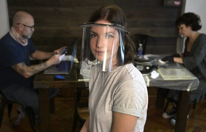 A woman wears a plastic face shield. Face shields may help prevent the spread of coronavirus through protecting the face and eyes, while also being comfortable.