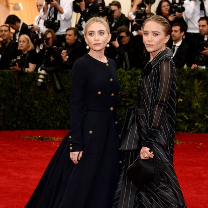 """Ashely Olsen (L) and Mary-Kate Olsen attend the """"Charles James: Beyond Fashion"""" Costume Institute Gala at the Metropolitan Museum of Art on May 5, 2014 in New York City."""