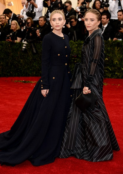 """Ashely Olsen (L) and Mary-Kate Olsen attend the """"Charles James: Beyond Fashion"""" Costume Institute G..."""