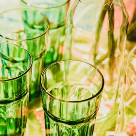Green glasses in a bar. How Women's Drinking Habits Have Changed For The Long-Term Thanks To The Pandemic.