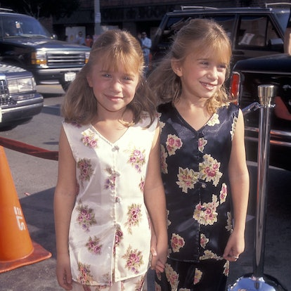 """Actressess Mary-Kate and Ashley Olsen attend the """"It Takes Two"""" Westwood Premiere on November 11, 1995 at the Mann National Theatre in Westwood, California."""