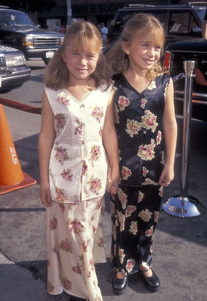 """Actressess Mary-Kate and Ashley Olsen attend the """"It Takes Two"""" Westwood Premiere on November 11, 19..."""