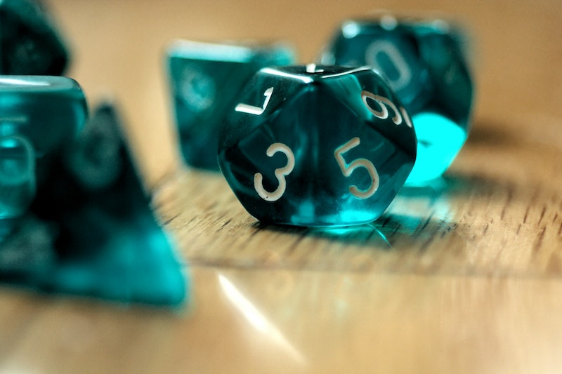 A set of teal die. Women explain how lockdown helped them get into role-playing games like dungeons and dragons.