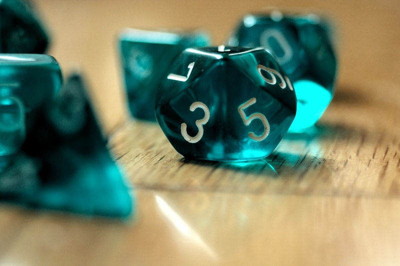 A set of teal die. Women explain how lockdown helped them get into role-playing games like dungeons ...