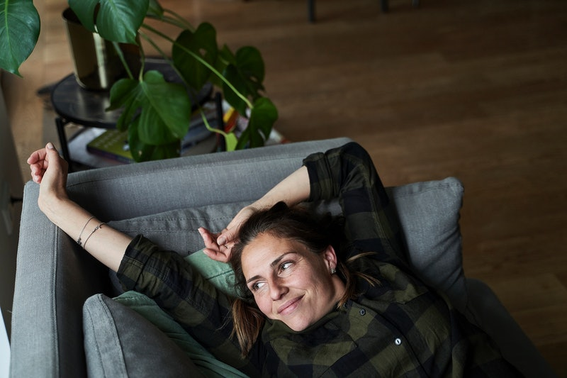 woman, stretching, couch