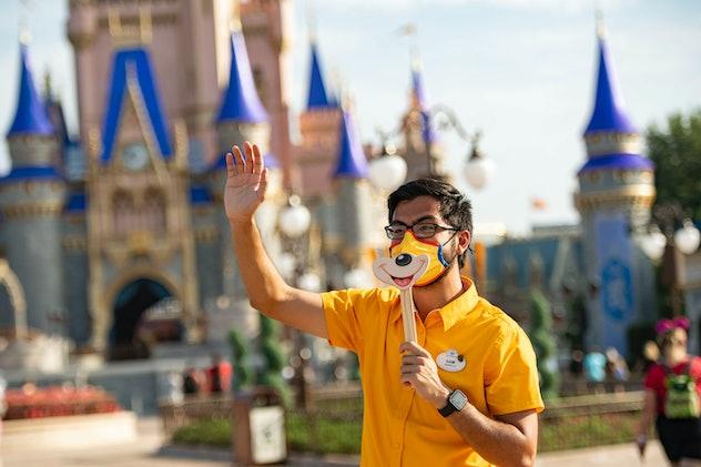 A Disney cast member holds up a smile.
