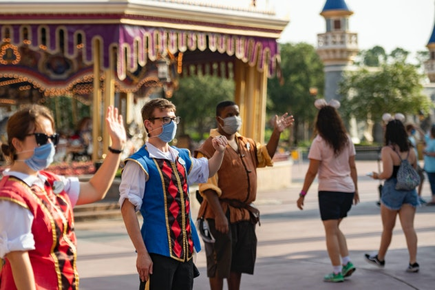 Cast members wore face masks while greeting guests on Saturday.