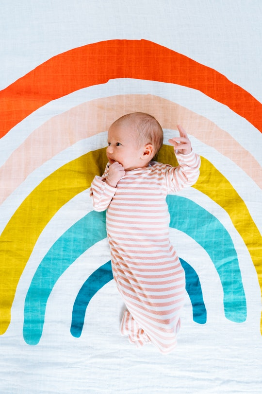 newborn baby on rainbow sheet