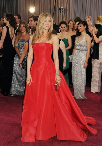 Jennifer Aniston wearing a red custom made Dior dress at the 2013 Academy Awards.