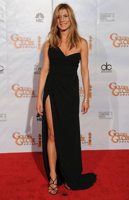 Jennifer Aniston wearing a black thigh-high slit dress at the 2010 Golden Globe Awards.