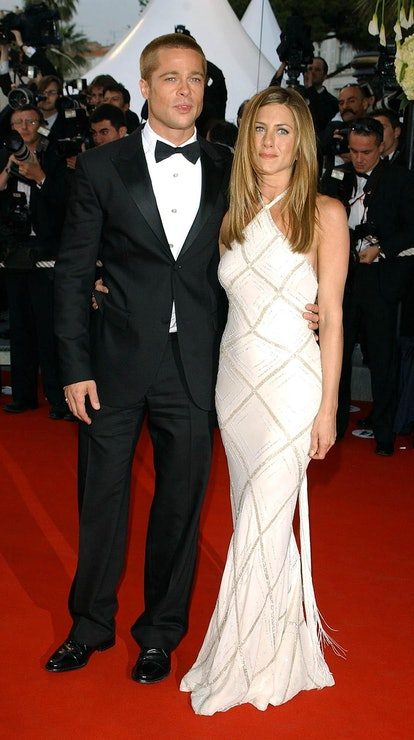 Jennifer Aniston wearing a white and gold halter neck Versace dress at the 2004 Cannes Film Festival...