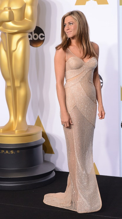 Jennifer Aniston wearing a Versace one-shoulder dress at the 2015 Oscars.