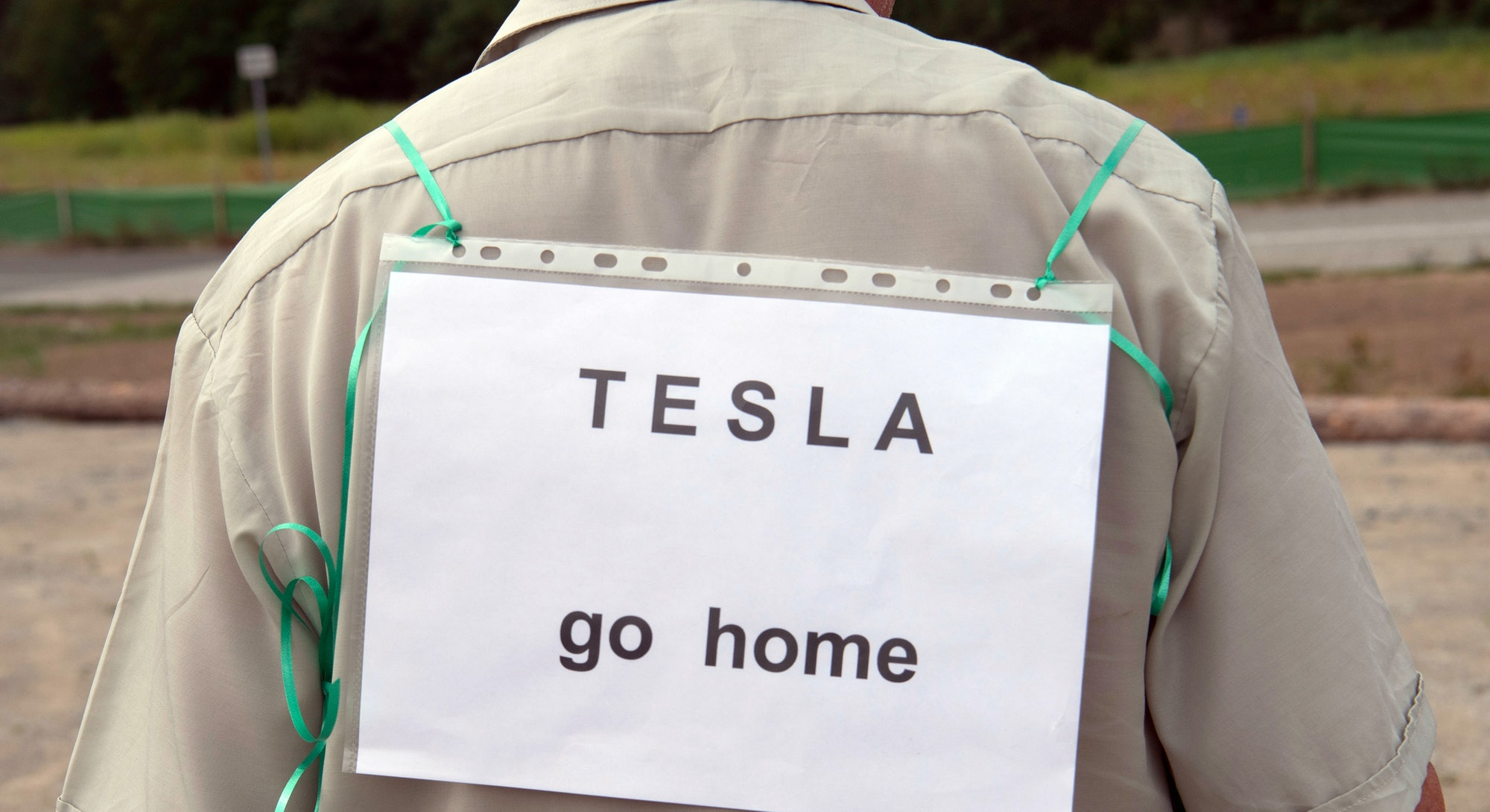 A crowd demonstrates against the settlement of Tesla in Grunheide, Germany.