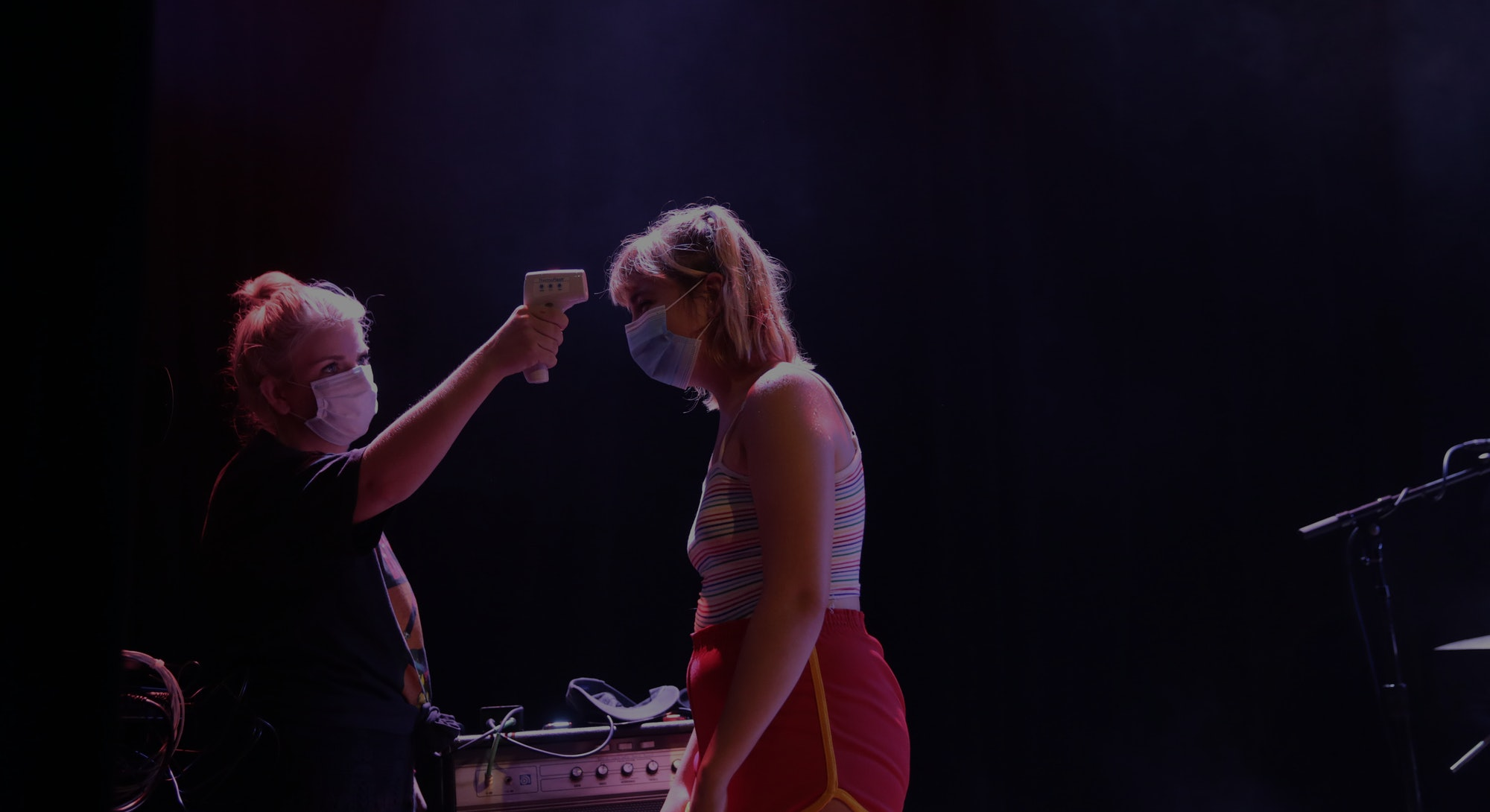 Production manager Emily Egerton takes the temperature of Lili Trifilio of Beach Bunny at Lincoln Hall in Chicago, Illinois on July 15, 2020.