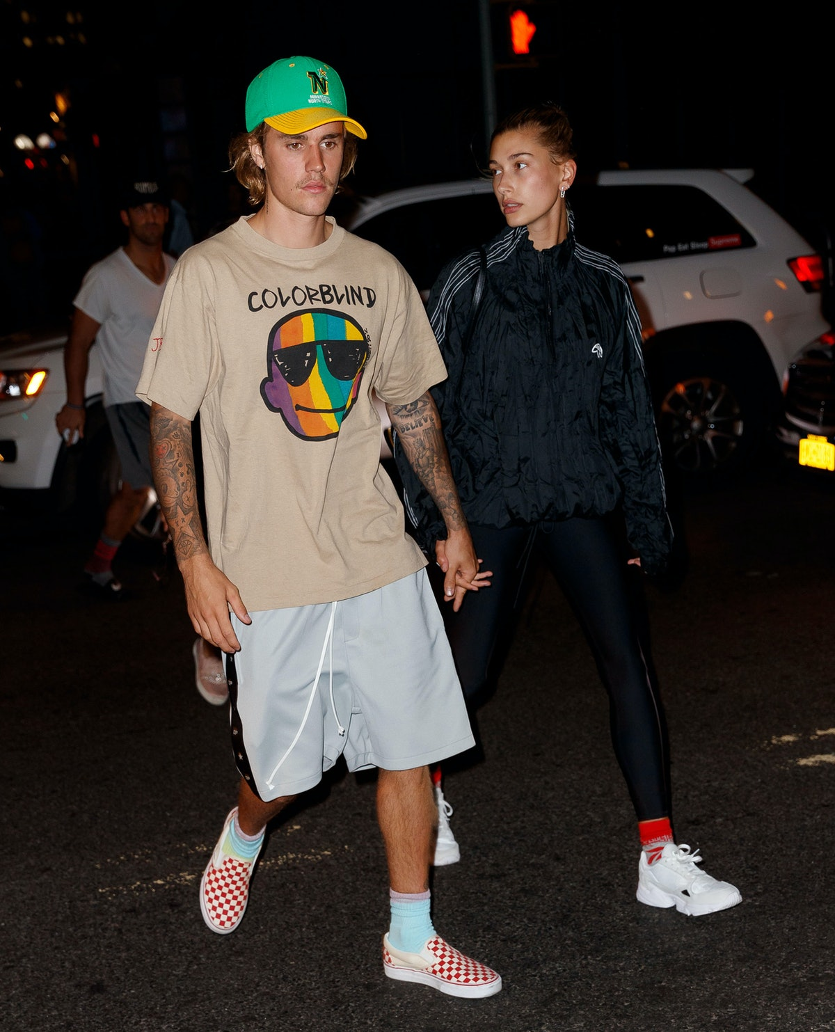 Justin Bieber and Hailey Bieber holding hands.