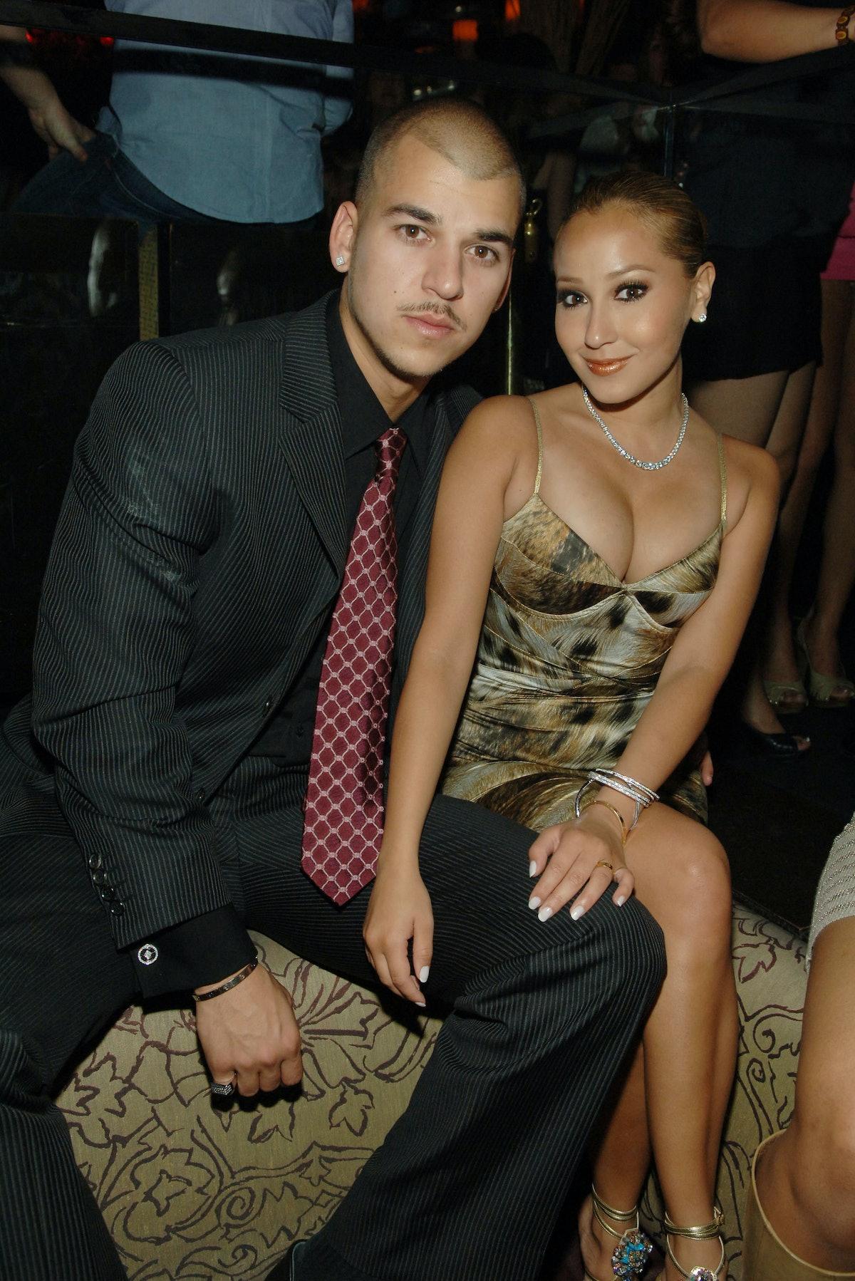 Rob Kardashian and Adrienne Bailon pose for a photo.
