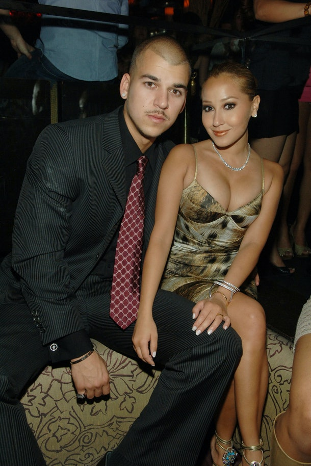Rob Kardashian and Adrienne Bailon pose for a photo.