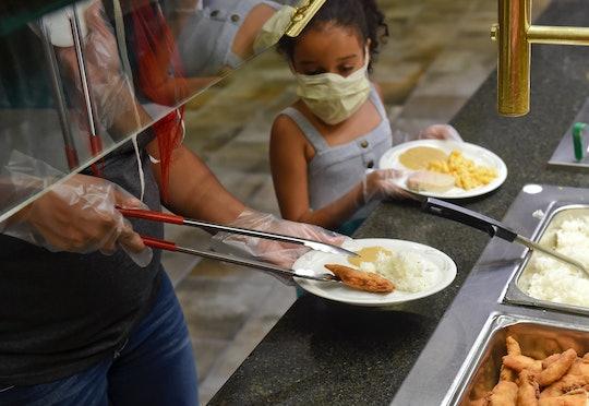 little girl at buffet in restaurant, coronavirus