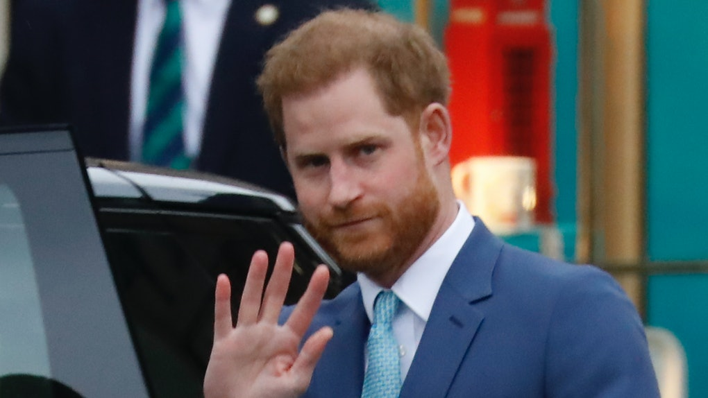Prince Harry waves to fans.