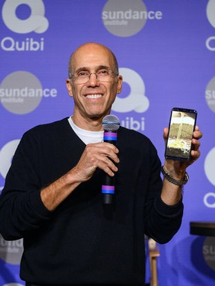 Jeffrey Katzenberg holding up a phone running Quibi.