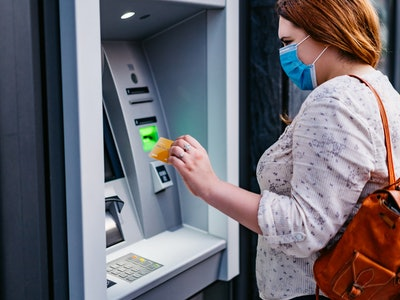 woman in face mask at atm
