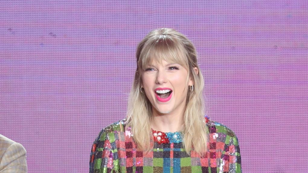 Taylor Swift rocks a sequin mini-dress.
