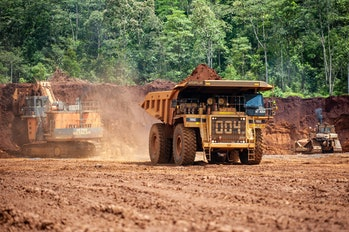 Heavy trucks working at a nickel mine in Indonesia in 2019.