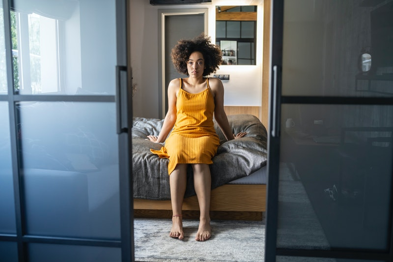 A woman gets out of bed after not sleeping. These 4 vitamin and mineral deficiencies can mess with your sleep.