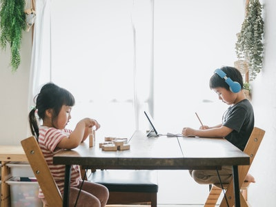 brother and sister sitting at table, homeschool