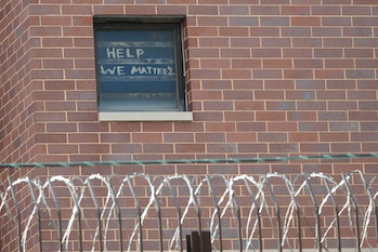 A message on the window of Cook County jail in Chicago, a coronavirus hotspot.