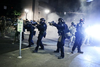 Armed police officers can be seen inching forward in Oregon during Black Lives Matter protests.